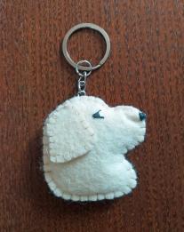 llavero perro blanco